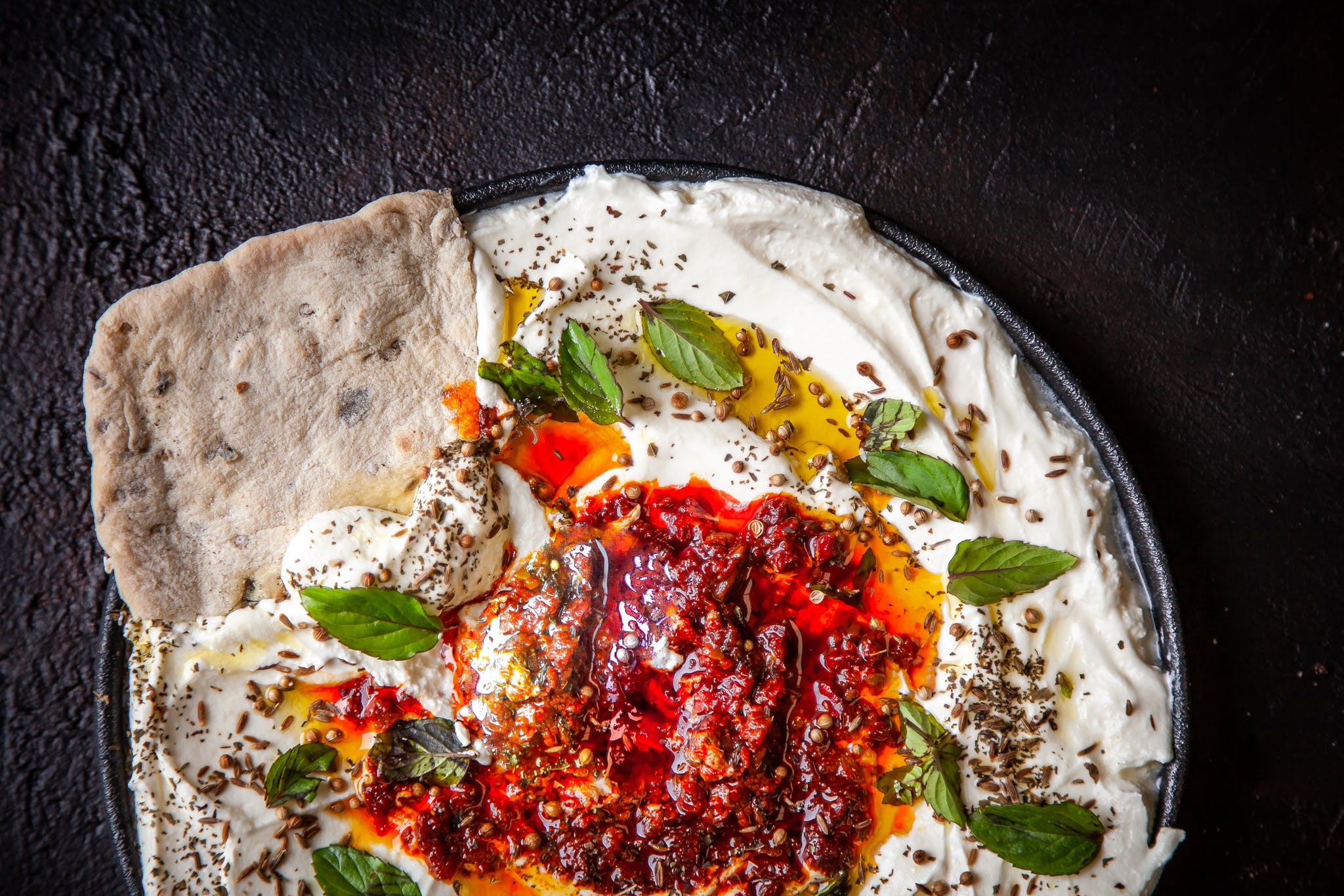 Greek Yoghurt and Harissa Dip with Black Olive Flatbreads