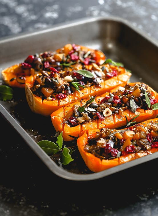 Roasted Butternut Squash stuffed with walnut, red onion and Cranberry