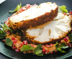 Spiced Roasted Cauliflower with Hummus and Pomegranate