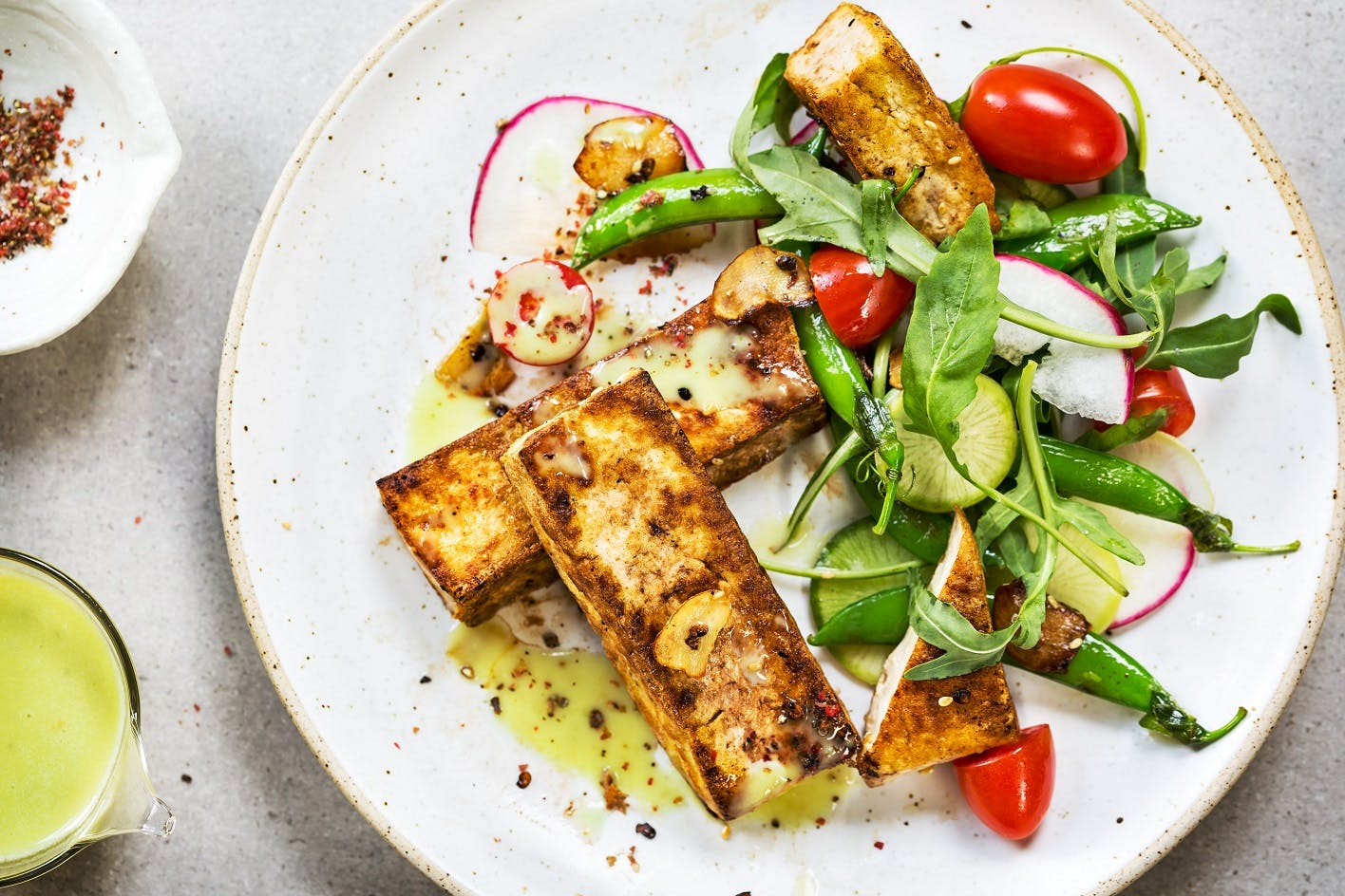Tofu Steak with Snow Peas, Rocket and Wasabi Dressing