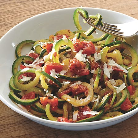 Courgetti Spaghetti with pesto and balsamic tomatoes